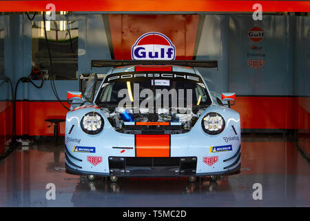 Gulf Racing Porsche 911 RSR in pit lane garage undergoing preparation for the WEC 6 Hours of Silverstone, 2018 - Stock Photo