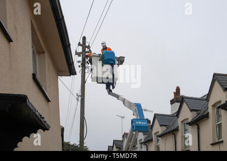 Workers for Western Power Distribution working to replace telegraph poles and electricity cables in Sidmouth, Devon, UK - Stock Photo