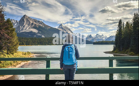 woman looking  by lake at Maligne Lake in Jasper National Park