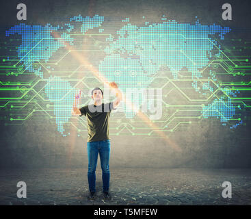 Man browsing a digital screen interface, searching a point on the world map. Male touching hologram display choosing a place on the globe. Business te - Stock Photo