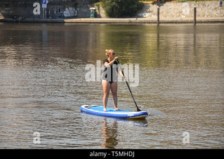 PRAGUE, CZECH REPUBLIC - AUGUST 2018: People paddle boarding on the River Vltava in Prague. The river runs through the centre of the city. - Stock Photo