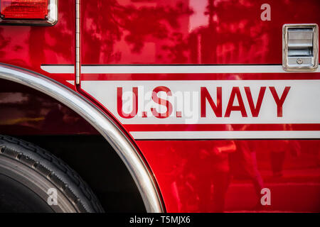 A crowd reflects on the door of a US Navy fire truck on display at Naval Base Yokosuka. - Stock Photo