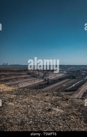 Coal mining landscape with big excavator in front near boxberg, germany - Stock Photo