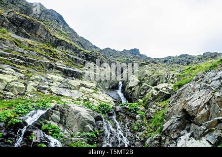 The waterfall called Balea on the Transfagarasan road from Fagaras mountains. - Stock Photo
