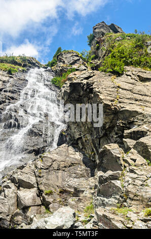 The waterfall called Balea on the Transfagarasan road from Fagaras mountains. - Stock Photo