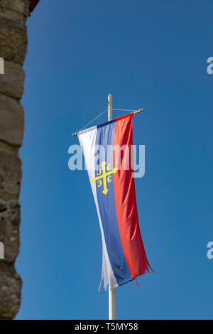 Flag of the Serbian Orthodox Church on blue sky background. Montenegro. - Stock Photo