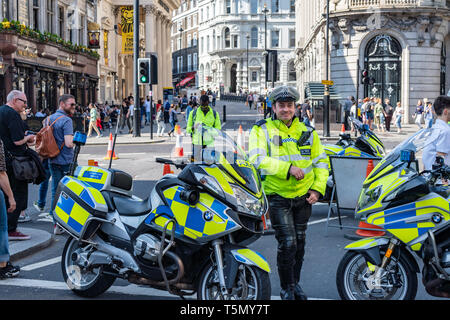 London, UK - April 19, 2019: Police Officers Guard During Protest, Metropolitan Police - Stock Photo