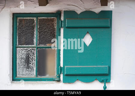 Close up of window and decorative shutter of Spanish style building in the historic La Plaza district of Palm Spring, California USA - Stock Photo
