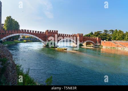 View of Ponte di Castelvecchio or Castel Vecchio Bridge over Adige River in Verona. Italy - Stock Photo