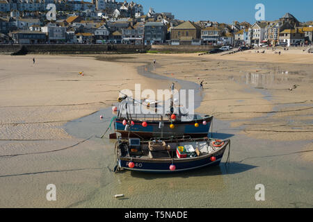 Fishing boats at low tide, St Ives harbour, Cornwall, England - Stock Photo