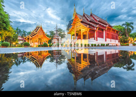 Wat Phra Singh in Chiang Mai, Thailand at dusk. - Stock Photo