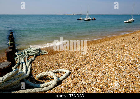 Small sailing boats anchored just off the beach at Colwell Bay in beautifully sunny weather, Isle of Wight, UK. - Stock Photo