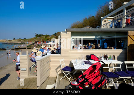 The Hut Beach Bar and Restaurant on a busy Easter weekend Saturday at Colwell Bay, Isle of Wight, UK. - Stock Photo