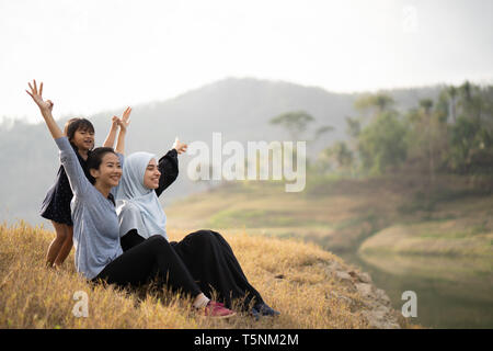 muslim woman friend and daughter - Stock Photo