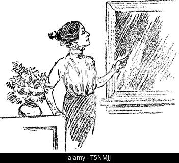 A woman standing near table and looking out of window, vintage line drawing or engraving illustration - Stock Photo
