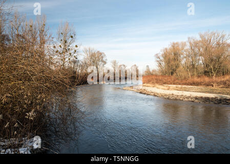 Odra river with view tower on tha background on czech-polish borders near Bohumin and Chalupki cities during beautiful winter day with blue sky - Stock Photo