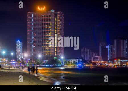 Nha Trang, Vietnam - February 19 2019: MƯỜNG THANH GRAND NHA TRANG HOTEL cityscape Vietnam by night - Stock Photo