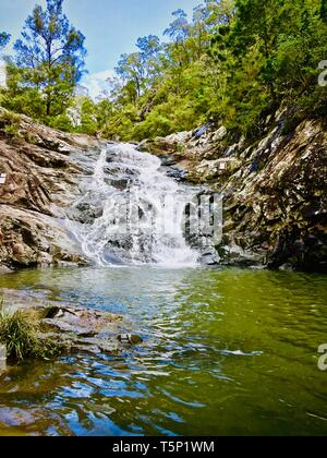 beautiful scenic waterfall in the rainforest. swimming hole and romantic place for lovers. - Stock Photo