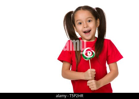 surprised cute little child girl with sweet candy lollipop isolated on white background - Stock Photo