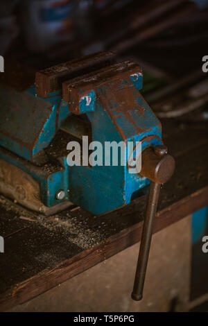 close up shot of an old rusty vise in a garage, tool - Stock Photo