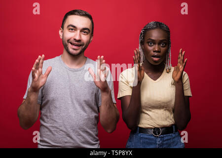 Shocked African American young female and male look with scared frightened expressions at camera, being stunned to recieve bill, have no money for pay - Stock Photo