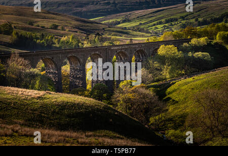 Looking down over Dent Head Viaduct with late afternoon light on the valley. - Stock Photo