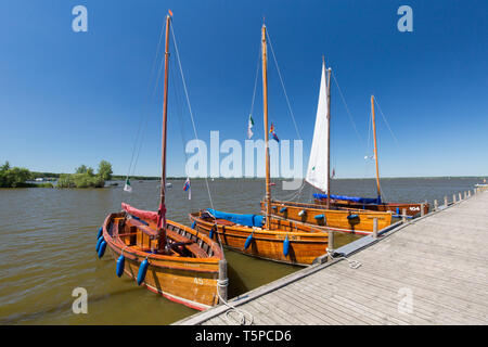 Auswanderer, old wooden sailing boats moored at jetty on Lake Steinhude / Steinhuder Meer in summer, Mardorf, Lower Saxony / Niedersachsen, Germany - Stock Photo
