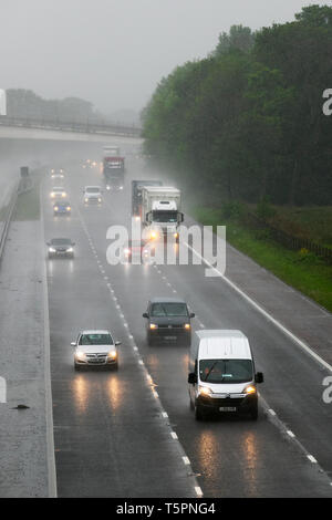 Lancaster, Lancashire. 26th April, 2019. UK Weather. Heavy rain in the north-west on the M6 as storm Hannah approaches. Severe weather warnings have been issued and drivers heading home for the weekend are facing increasing difficult driving conditions, Credit: MediaWorldImages/Alamy Live News - Stock Photo