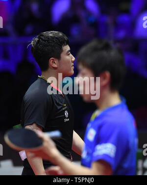Budapest. 26th Apr, 2019. Liang Jingkun(L) of China reacts during the men's singles quarterfinals match between Liang Jingkun of China and Niwa Koki of Japan at 2019 ITTF World Table Tennis Championships in Budapest, Hungary on April 26, 2019. Credit: Lu Yang/Xinhua/Alamy Live News - Stock Photo