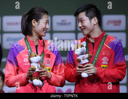 Budapest. 26th Apr, 2019. Ding Ning(L)/Fan Zhendong of China pose during the awarding ceremony of the mixed doubles at 2019 ITTF World Table Tennis Championships in Budapest, Hungary on April 26, 2019. Credit: Tao Xiyi/Xinhua/Alamy Live News - Stock Photo