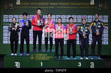 Budapest. 26th Apr, 2019. Medalists pose on the podium during the awarding ceremony of the mixed doubles at 2019 ITTF World Table Tennis Championships in Budapest, Hungary on April 26, 2019. Credit: Tao Xiyi/Xinhua/Alamy Live News - Stock Photo