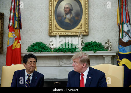 Washington, DC, USA. 26th Apr, 2019. US President Donald J. Trump meets with Japanese Prime Minister Shinzo Abe in the Oval Office of the White House in Washington, DC, USA, 26 April 2019. President Trump is hosting a dinner for Prime Minister Abe and his wife celebrating the First Lady's 49th birthday Credit: Shawn Thew/Pool via CNP | usage worldwide Credit: dpa/Alamy Live News - Stock Photo