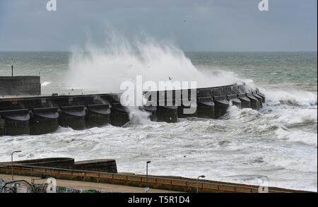 Brighton, UK. 27th Apr, 2019. Huge waves crash over Brighton Marina wall as Storm Hannah hits Britain this morning with strong winds forecast to affect parts of the country Credit: Simon Dack/Alamy Live News - Stock Photo
