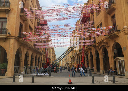 Beirut, Lebanon. 27th Apr, 2019. People aim to break the Guinness Book of World Records  by Raising 26,852 small Lebanese Flags in One Day in Downtown Nejmeh Square breaking the previous  record held  in New York since 2000 Credit: amer ghazzal/Alamy Live News - Stock Photo