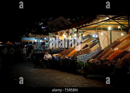FEZ, MOROCCO - November 4, 2012: Jamaa el Fna market square after dark, Marrakesh, Morocco, north Africa. Jemaa el-Fnaa, Djema el-Fna or Djemaa el-Fna - Stock Photo