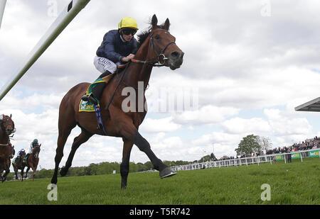 Crystal Ocean ridden by Ryan Moore wins the bet365 Gordon Richards Stakes at Sandown Park Racecourse, Esher. - Stock Photo