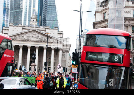 Extinction Rebellion protest, London . April 25th 2019. Rebels swarm at Bank stopping traffic for seven minutes at a time to draw attention to the cli - Stock Photo