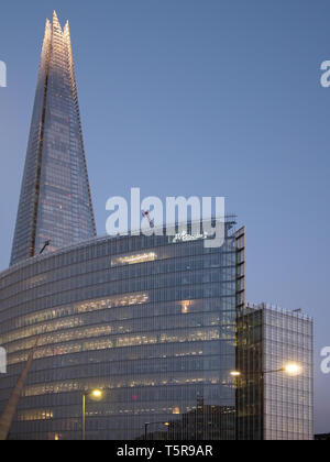 London,UK - 21 APR 2019: The Shard and surrounding modern glass buildings at dusk. - Stock Photo