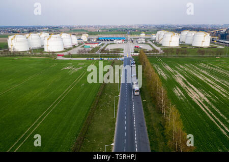 Aerial view on refineries oil big tanks and train transfering station. - Stock Photo