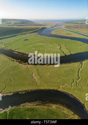 Beautiful aerial drone vertical panorama landscape image of meandering river through marshland at sunrise - Stock Photo