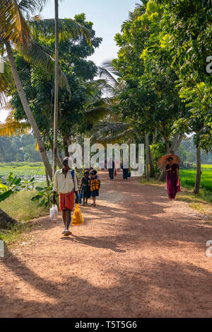 Vertical view of people walking along the riverbank in Alleppy, India - Stock Photo