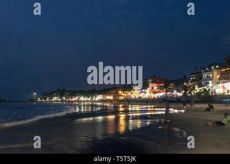 Horizontal view of Lighthouse beach in Kovalam Kerala at night, India. - Stock Photo