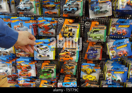 Die-cast toy cars in a blister pack in a store display - Stock Photo