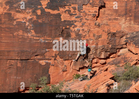 Las Vegas, Nevada / USA - March-25-2016 Editorial photo of two young female rock climbers in Red Rock Canyon National park - Stock Photo