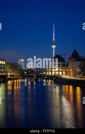 Bode Museum and other buildings and their reflections on the Spree River in Berlin, Germany, at dusk. Fernsehturm TV Tower is in the background. - Stock Photo