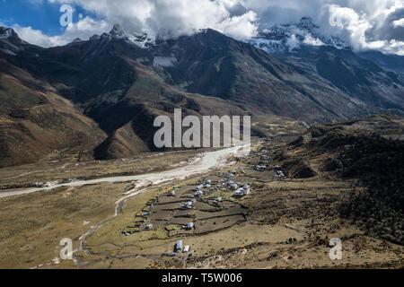The remote village of Chozo and its mountains, Lunana Gewog, Gasa District, Snowman Trek, Bhutan - Stock Photo