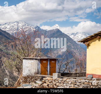 Toilets with a view - outside lavatories in Supi village with views over the high Himalayas Nanda Kot and the Pindar Valley in Uttarakhand India - Stock Photo