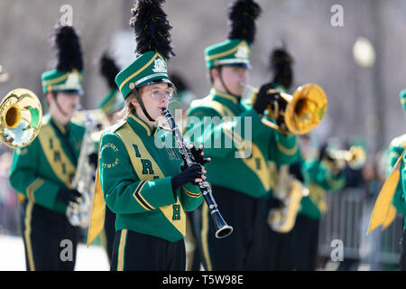 Chicago, Illinois, USA - March 16, 2019: St. Patrick's Day Parade, The St. Vincent - St. Mary Fighting Irish Marching Band going down Columbus drive a - Stock Photo