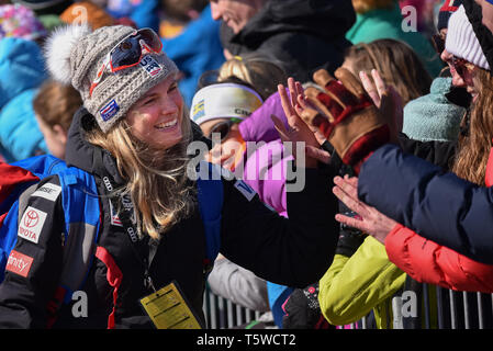 US Cross Country Ski Team member Jessie Diggins (left) high fives fans at the FIS World Cup cross country ski races in Quebec City, Canada, 2019. - Stock Photo