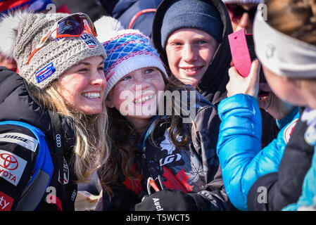 US Cross Country Ski Team member Jessie Diggins (left) poses with fans at the FIS World Cup cross country ski races in Quebec City, Canada, 2019. - Stock Photo